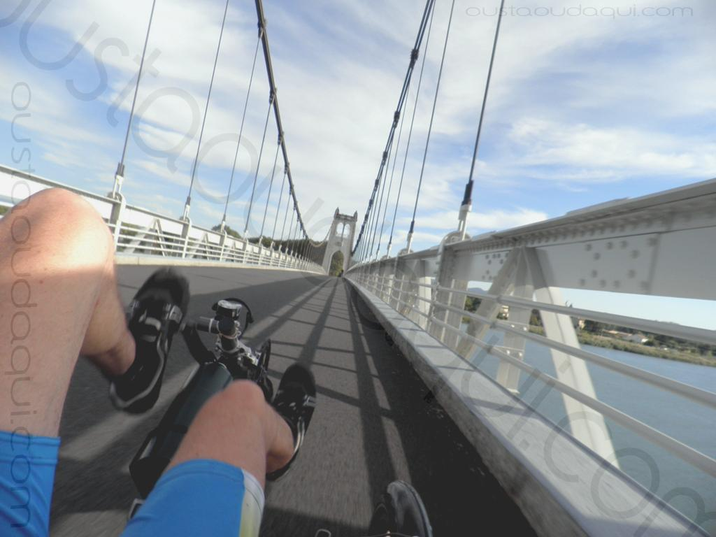picture taken along the  EuroVelo 17:  bent cycling on the suspension bridge of La Voulte-sur-Rhône (completed in 1889 - renewed in 2016) - central pillar