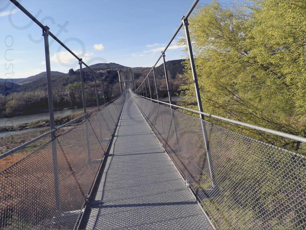 picture taken along the  EuroVelo 17: Himalayan-style footbridge at Rochemaure (old bridge restored in 2013-for pedestrian and ViaRhôna traffic only)1,40 metre wide and 340 metres long